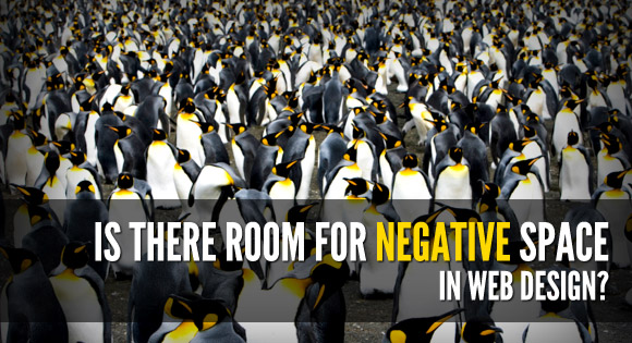 a crowd of penguins on the beach - where's the negative space?